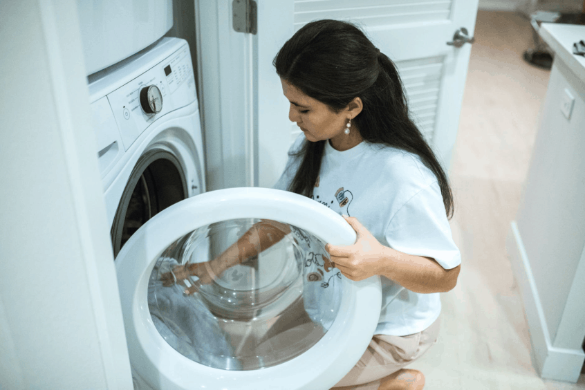 Women Inspecting Her Clothing From Her Modern Dryer
