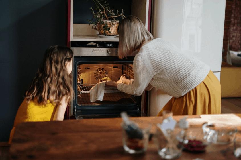 family enjoying a newly fixed oven
